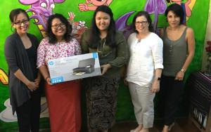 Third Story Project founders receiving printer donation from WBFN